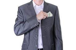 Businessman Putting Money in Your Pocket. Isolated Stock Photos