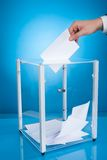 Businessman putting paper in election box Royalty Free Stock Image