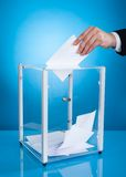 Businessman putting paper in polling box Royalty Free Stock Photography