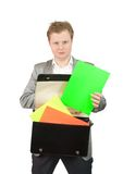 Businessman putting papers into briefcase Stock Image