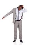 Businessman putting suit coat Stock Images