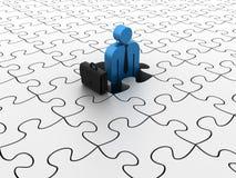 Businessman on Puzzle Stock Image