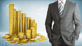 Businessman with pyramid of gold coins Royalty Free Stock Photo