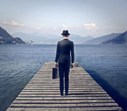 Businessman on a quay Stock Images