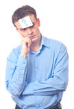 Businessman and question mark. Businessman with a  glued  sticker  with a question mark on his forehead Stock Images
