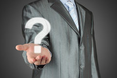 Businessman with question mark Royalty Free Stock Images
