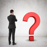 Businessman and question mark Stock Photos