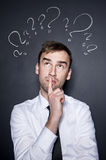 Businessman with question marks Stock Photo
