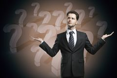 Choice and option concept. Businessman with question marks. Choice and option concept Stock Images