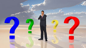 Businessman and question marks Royalty Free Stock Photography