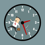 Businessman racing against the clock Stock Photo