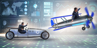 The businessman racing on car and airplane Stock Photo