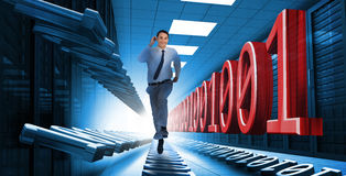 Businessman racing through data center Royalty Free Stock Photos