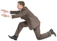 Businessman racing forward Stock Photo