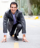 Businessman in racing position Stock Photos