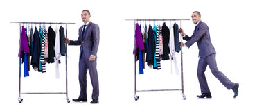 The businessman with rack of clothing Royalty Free Stock Photos