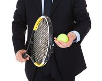 Businessman with racket and ball Royalty Free Stock Image