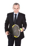 Businessman With Racket And Ball Stock Images