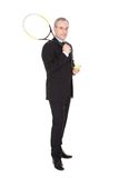 Businessman With Racket And Ball Royalty Free Stock Photo