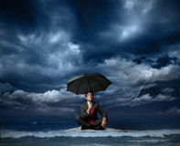 Businessman on a raft. In the storm Royalty Free Stock Image