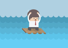 Businessman on a raft in the middle of the sea Stock Photography