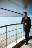 Businessman by railings Royalty Free Stock Image