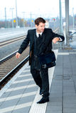 Businessman on railroad station in hastiness Royalty Free Stock Images