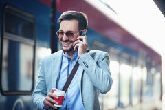 Businessman on railroad station Stock Photography