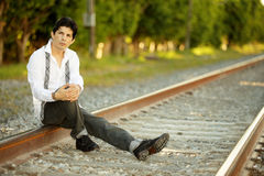 Businessman on the railroad tracks Royalty Free Stock Image
