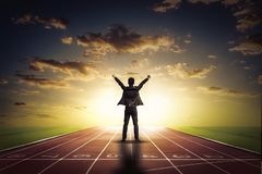 Businessman raise arms up in victory moment. Royalty Free Stock Images