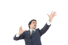 Businessman with raised hands reaching for something with blank Stock Images