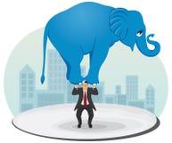 Businessman raises an elephant Stock Photography