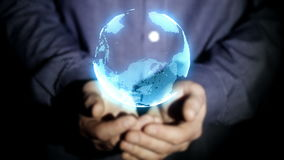 Businessman raises his hands,which projected a futuristic planet earth stock footage