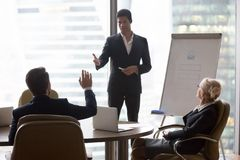 Businessman raising hand at corporate training ask questions african coach. Businessman raising hand at corporate training ask african american coach presenter royalty free stock images