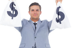 Businessman raising hands with money bags Stock Image