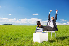 Businessman raising his arms Stock Images