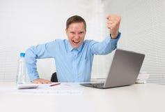 Businessman raising his fist Stock Image