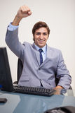 Businessman raising his fist in success Stock Image