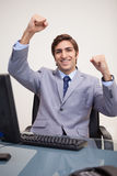 Businessman raising his fists in success Royalty Free Stock Images