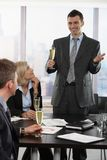 Businessman raising toast with champagne Royalty Free Stock Photography