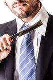 Businessman and razor Royalty Free Stock Image