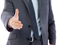Businessman reaching hand out Royalty Free Stock Images