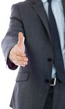 Businessman reaching hand out Royalty Free Stock Photo