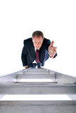 Businessman reaching for help Stock Photo