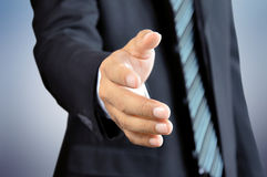 Businessman reaching his hand offering handshake Stock Photo