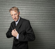 Businessman reaching in his jacket Stock Images