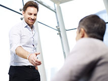 Businessman reaching out for a handshake Stock Images
