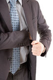 Businessman reaching out to his pocket Stock Photos