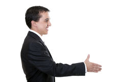 Businessman reaching out to shake hands Stock Image