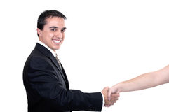 Businessman reaching out to shake hands Royalty Free Stock Photos